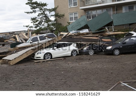 NEW YORK - November 1: Crashed cars after Hurricane Sandy  in the Far Rockaway area  on October 30, 2012 in New York City, NY - stock photo