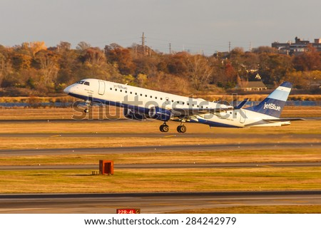 NEW YORK - NOVEMBER 3: Embraer 190 JetBlue Airways lands at JFK Airport in New York, NY on November 3, 2013. JetBlue is New York based, fastest growing airline in the world. - stock photo