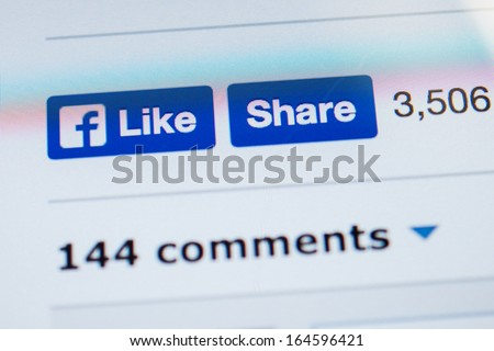 NEW YORK - NOVEMBER 13: Facebook introduced a new design for Like and Share buttons on 6 November 2013 . Like button no longer sports famous thumbs-up, but instead brandishes the Facebook lowercase f  - stock photo