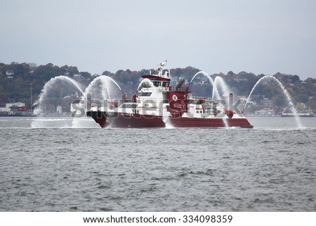 NEW YORK - NOVEMBER 2, 2015: FDNY fire boat sprays water into the air to celebrate the start of New York City Marathon 2015 in New York Harbor
