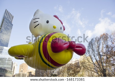 NEW YORK - NOVEMBER 28: Hello Kitty balloon flown on city street during the 87th Annual Macy's Thanksgiving Day Parade on November 28, 2013 in New York City.  - stock photo
