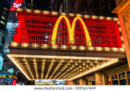 "NEW YORK - NOVEMBER 22, 2013. illuminated neon sign with the world famous ""M"" representing McDonalds along 42nd street in Times Square. The company was founded in 1940 in San Bernardino, California. - stock photo"