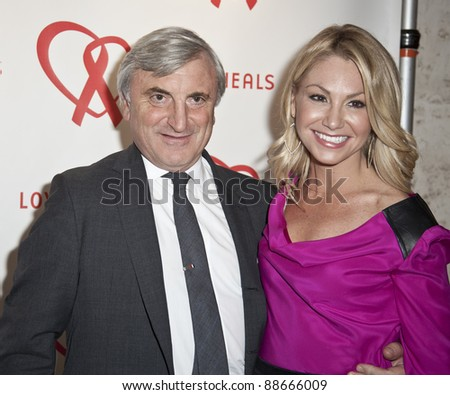 NEW YORK - NOVEMBER 09: Julian Niccolini and guest attend Love Heals The Alison Gertz Foundation For AIDS Education 20th Anniversary gala at the Four Seasons Restaurant on November 9, 2011 in New York City, NY. - stock photo