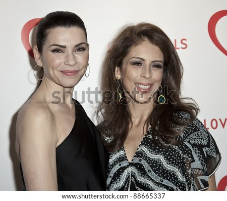 NEW YORK - NOVEMBER 09: Julianna Margulies, Dini von Mueffling attend Love Heals The Alison Gertz Foundation For AIDS Education 20th Anniversary gala at Four Seasons Restaurant on Nov 9, 2011 in New York City, NY. - stock photo