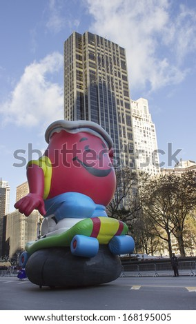 NEW YORK - NOVEMBER 28: Kool-Aid float on city street during the 87th Annual Macy's Thanksgiving Day Parade on November 28, 2013 in New York City.  - stock photo