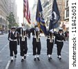 NEW YORK - NOVEMBER 11: Members of US Navy walk at Veteran's Day Parade along 5th Avenue on November 11, 2012 in New York City - stock photo
