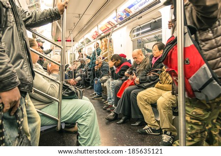 NEW YORK - NOVEMBER 2, 2013: mixed people in the subway, downtown Manhattan. The trains are the places where the most mixed melting pot in the world take place, and the real mirror of actual society. - stock photo