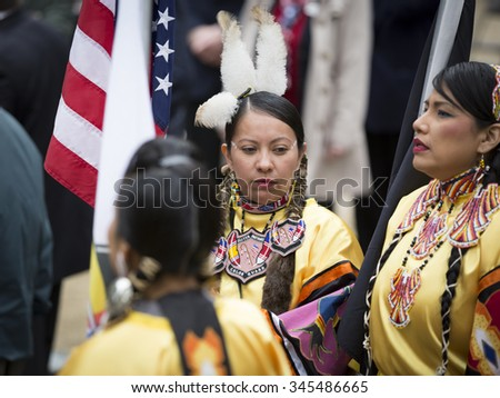 NEW YORK - NOVEMBER 11 2015: Native American women veterans from Sister Nations Color Guard assemble in Native regalia in Madison Square Park before the parade up 5th Ave on Veterans Day in Manhattan. - stock photo
