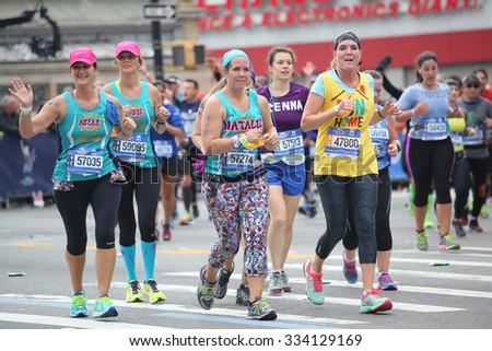 NEW YORK - NOVEMBER 1, 2015: New York City Marathon runners traverse 26.2 miles through all five NYC boroughs to the finish line in Central Park, Manhattan