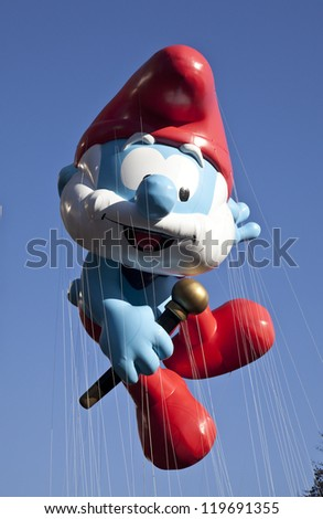 NEW YORK - NOVEMBER 22: Papa Smurf balloon is flown at the 86th Annual Macy's Thanksgiving Day Parade on November 22, 2012 in New York City. - stock photo
