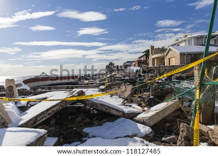 NEW YORK - NOVEMBER 8, 2012:Pile of debris and boat near flooded and damaged houses after Hurricane Sandy  on Manhattan Beach on November 8, 2012, Brooklyn, NY - stock photo