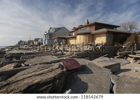 NEW YORK - NOVEMBER 12:Pile of garbage, debris near flooded and damaged house after Hurricane Sandy  on Manhattan Beach on November 12, 2012, Brooklyn, NY