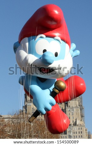 NEW YORK - NOVEMBER 22: Smurf balloon is flown at the 86th Annual Macy's Thanksgiving Day Parade on November 22, 2012 in New York City. - stock photo
