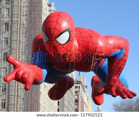 NEW YORK - NOVEMBER 24: Spider-man balloon is flown at the 86th Annual Macy's Thanksgiving Day Parade on November 24, 2011 in New York City. - stock photo