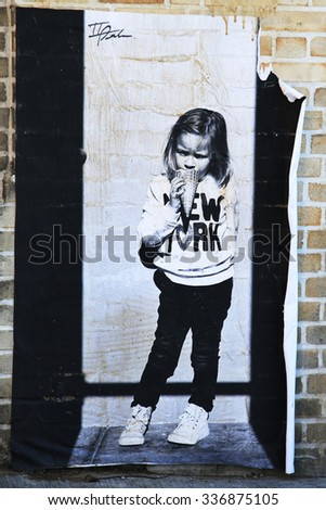 NEW YORK - NOVEMBER 8, 2015: Stencil art at East Williamsburg in Brooklyn.Outdoor art gallery known as the Bushwick Collective has most diverse collection of street art in Brooklyn
