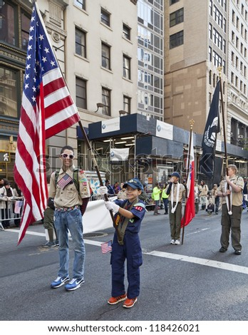 NEW YORK - NOVEMBER 11: Unidentified boy scouts walks at Veteran's Day Parade along 5th Avenue on November 11, 2012 in New York City - stock photo