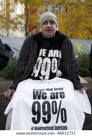 NEW YORK - NOVEMBER 14: Unidentified protester with 'Occupy Wall Street' offer t-shirts in exchange for donations on November 14, 2011 in New York. - stock photo