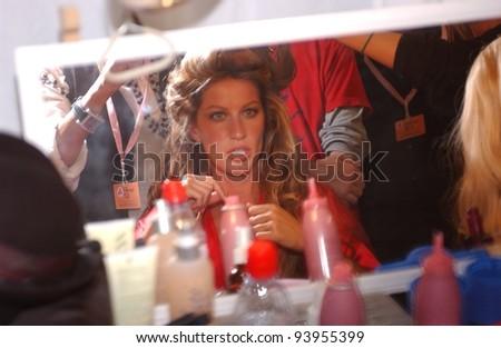 NEW YORK - NOVEMBER 9: Victoria's Secret Fashion model Gisele Bundchen getting ready backstage during the 2010 Victoria's Secret Fashion Show on November 9, 2005 at the Lexington Armory in New York - stock photo