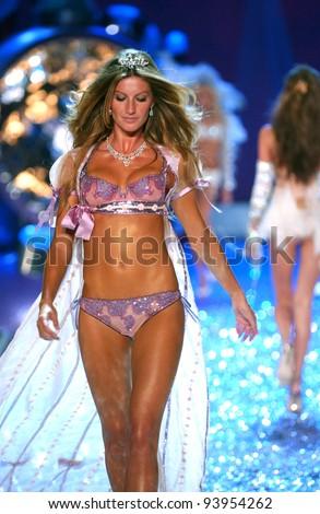 NEW YORK - NOVEMBER 9: Victoria's Secret Fashion model Gisele Bundchen walks the runway during the 2010 Victoria's Secret Fashion Show on November 9, 2005 at the Lexington Armory in New York City. - stock photo