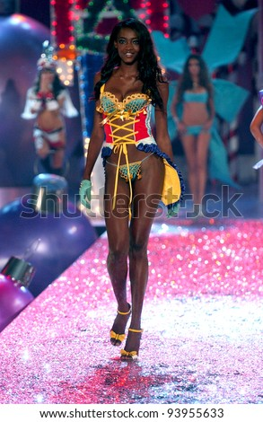 NEW YORK - NOVEMBER 9: Victoria's Secret Fashion model Oluchi Onweagba walks the runway during the 2010 Victoria's Secret Fashion Show on November 9, 2005 at the Lexington Armory in New York City.