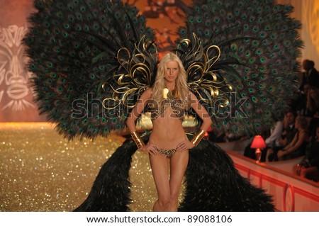 NEW YORK - NOVEMBER 10: Victoria's Secret Fashion Show model Karolina Kurkova walks the runway during the 2010 Victoria's Secret Fashion Show on November 10, 2010 at Lexington Armory in New York. - stock photo