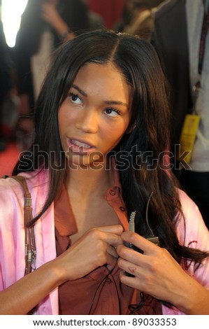 NEW YORK - NOVEMBER 10: Victoria's Secret model  Chanel Iman getting ready backstage  during the 2010 Victoria's Secret Fashion Show on November 10, 2010 at the Lexington Armory in New York.