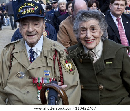 NEW YORK - NOVEMBER 11: World War II veterans Rocco Moretto and Margie Zwick attend opening ceremony Veteran's Day Parade in Madison Square Park on November 11, 2012 in New York City - stock photo