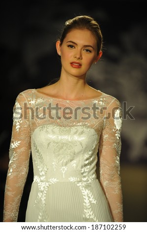 NEW YORK, NY - APRIL 11: A model walks the runway during the Carolina Herrera Spring 2015 Bridal collection show at on April 11, 2014 in New York City.