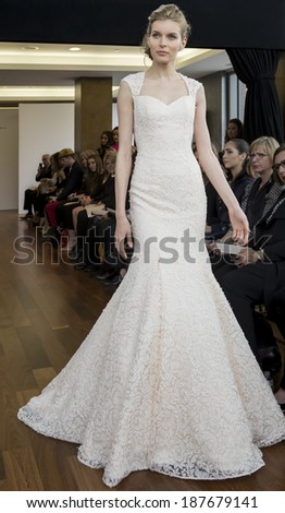 NEW YORK, NY - APRIL 11, 2014: A model walks the runway wearing Isabelle Armstrong Spring 2015 Bridal collection at the Penthouse 45