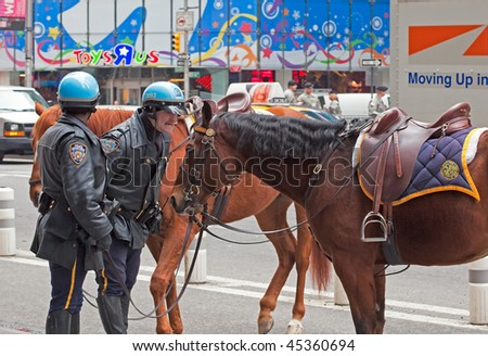 NEW YORK, NY - APRIL 1: A New York City Police officer scolds his misbehaving horse on April 1, 2009 in New York City. - stock photo