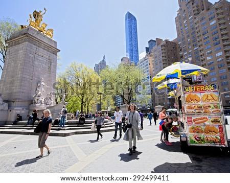 New York, NY - April 29, 2015: Columbus Circle in Manhattan on a bright sunny day - stock photo