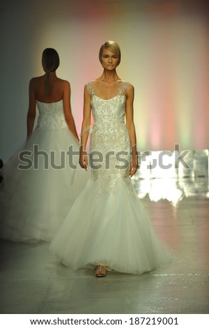 NEW YORK, NY - APRIL 11: Elena Kurnosova walks the runway during the RIVINI Spring 2015 Bridal collection show at on April 11, 2014 in New York City.