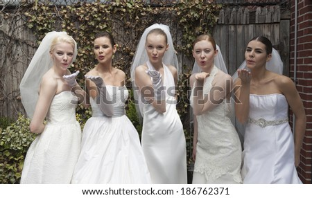 NEW YORK, NY - APRIL 11, 2014: Models show off wedding dresses by Justina McCaffrey during bridal week at penthouse of Morgans hotel - stock photo