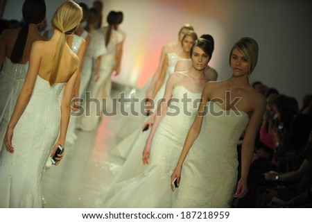 NEW YORK, NY - APRIL 11: Models walk the runway finale during the RIVINI Spring 2015 Bridal collection show at on April 11, 2014 in New York City. - stock photo