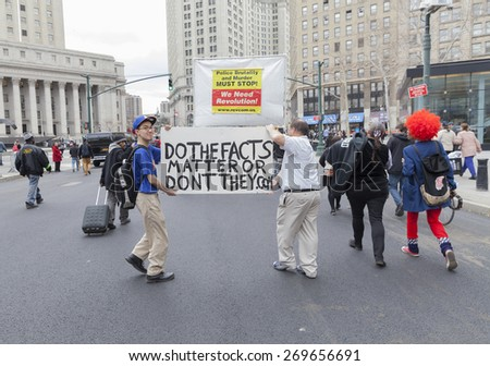 New York, NY - April 14, 2015: Protesters against police brutality walk down around Foley SQuare with sign against CNN reports