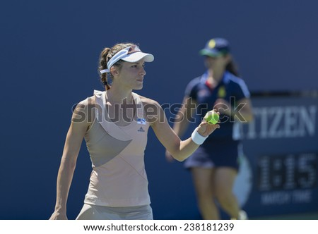 NEW YORK, NY - AUGUST 25: Andrea Petkovic of Germany serves ball during 1st round match against Ons Jabeur of Tunisia at US Open tennis tournament in Flushing Meadows USTA Tennis Center 2014 - stock photo
