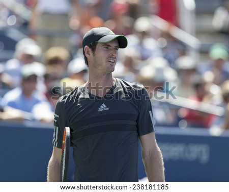 NEW YORK, NY - AUGUST 25: Andy Murray of United Kingdom reacts during 1st round match against Robin Haase of Netherland at US Open tennis tournament in Flushing Meadows USTA Tennis Center 2014 - stock photo