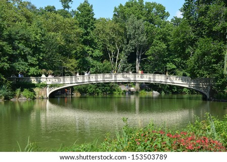 NEW YORK, NY - AUGUST 6: Bridge in Central park on August 6, 2013 in New York, NY. Central park is the biggest city park in the world - stock photo
