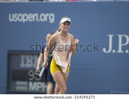 NEW YORK, NY - AUGUST 31, 2014: Caroline Wozniacki of Denmark reacts during 4th round match against Maria Sharapova of Russia at US Open tennis tournament in Flushing Meadows USTA Tennis Center - stock photo