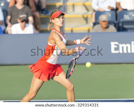 New York, NY - August 31, 2015: Euginie Bouchard of Canada returns ball during 1st round match against Alison RIske of USA at US Open Championship  - stock photo