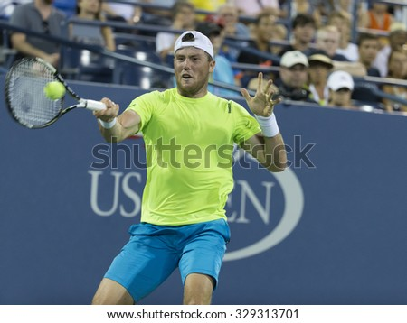 New York, NY - August 31, 2015: Ilya Marchenko of Ukraine returns ball during 1st round match against Gael Monfils of France at US Open Championship - stock photo
