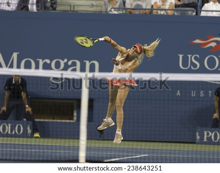 NEW YORK, NY - AUGUST 25: Maria Kirilenko of Russia serves ball during 1st round match against Maria Sharapova of Russia at US Open tennis tournament in Flushing Meadows USTA Tennis Center 2014 - stock photo