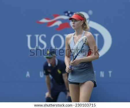 NEW YORK, NY - AUGUST 31, 2014: Maria Sharapova of Russia reacts during 4th round match against Caroline Wozniacki of Denmark at US Open tennis tournament in Flushing Meadows USTA Tennis Center - stock photo