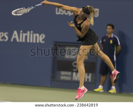 NEW YORK, NY - AUGUST 25: Maria Sharapova of Russia serves ball during 1st round match against Maria Kirilenko of Russia at US Open tennis tournament in Flushing Meadows USTA Tennis Center 2014 - stock photo