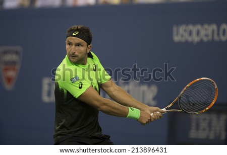 NEW YORK, NY - AUGUST 26: Marinko Matosevic of Australia returns ball during 1st round match against Roger Federer of Switzerland at US Open tennis tournament in Flushing Meadows USTA Tennis Center