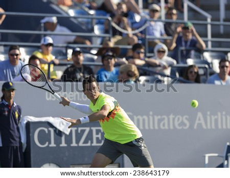NEW YORK, NY - AUGUST 25: Milos Raonic of Canada returns ball during 1st round match against Taro Daniel of Japan at US Open tennis tournament in Flushing Meadows USTA Tennis Center 2014 - stock photo