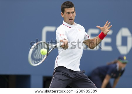 NEW YORK, NY - AUGUST 30, 2014: Novak Djokovic of Serbia returns ball during 3rd round match against Sam Querrey of USA at US Open tennis tournament in Flushing Meadows USTA Tennis Center - stock photo