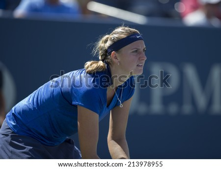 NEW YORK, NY - AUGUST 30, 2014: Petra Kvitova of Czech Republic returns ball during 3rd round match against Aleksandra Krunic of Serbia at US Open championship in Flushing Meadows USTA Tennis Center