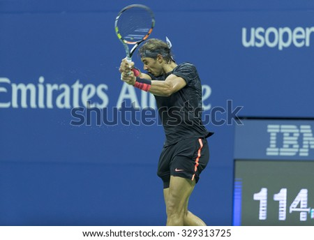 New York, NY - August 31, 2015: Rafael Nadal of Spain returns ball during 1st round match against Borna Coric of Croatia at US Open Championship - stock photo