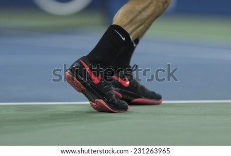 NEW YORK, NY - AUGUST 29, 2014: Roger Federer of Switzerland prepares to serve during 2nd round match against Sam Groth of Australia at US Open tennis tournament in Flushing Meadows USTA Tennis Center - stock photo